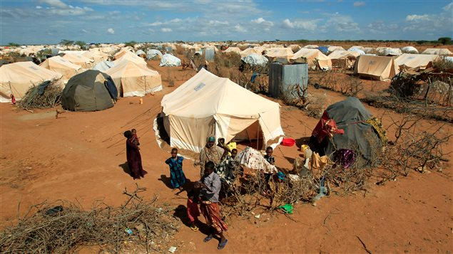 Refugees stand outside their tent at the Ifo Extension refugee camp in Dadaab, near the Kenya-Somalia border in Garissa County, Kenya October 19, 2011.