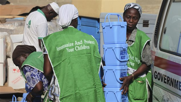 Local health workers carry vaccination kits at a distribution centre ahead of the start of a nationwide polio immunization campaign on Wednesday, in Lagos February 21, 2011.