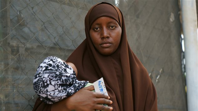 Generations growing up in Dadaab: Twenty-year-old mother of two Maryan Ma'alin Abdi, a Somali refugee who was born in Dagahaley camp, Dadaab. Pictured here with her one year old daughter Fowisiyo. CARE / Lucy Beck