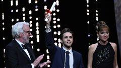 Xavier Dolan, entouré de Donald Sutherland et Valeria Golino, deux membres du jury