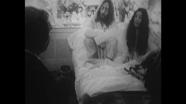 John and Yoko in a heated discussion with American cartoonist in Room 1742 of the Queen Elizabeth Hotel in Montreal in May 1969 during their Canadian 'bed-in'