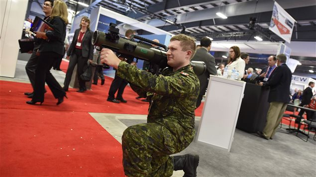 Bombardier Kody Young checks out a Carl Gustav recoilless weapon at the Canadian Association of Defence and Security Industries' CANSEC trade show in Ottawa on Wednesday, May 27, 2015.