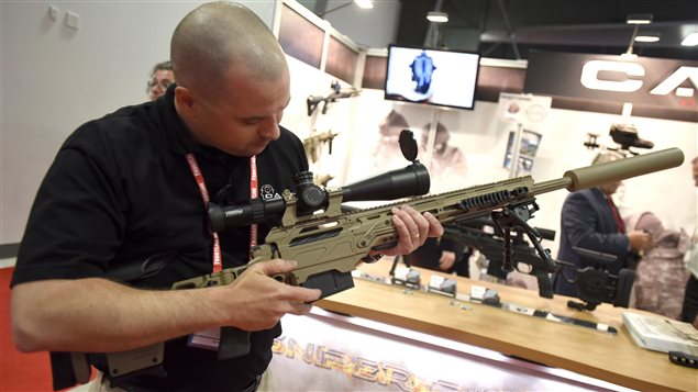 Patrice Picard shows off a CADEX sniper rifle at the Canadian Association of Defence and Security Industries' CANSEC trade show in Ottawa on Wednesday, May 27, 2015.