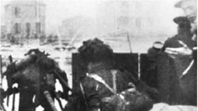 Screen grab of Canadian film footage of the landing of A-Company, the North Shore Regiment (New Brunswick) landing under fire in the early waves of troops onto the beach. The Canadian film was the first to be shown of the D-Day landings.
