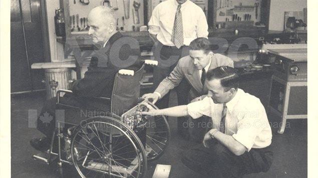 Inventor George Klein and others at NRC, 1953. The now ubiquitous *mobility scooters* one sees everywhere are an evolution of the electric wheelchair which itself was invented by Klein, another world's first for the NRC