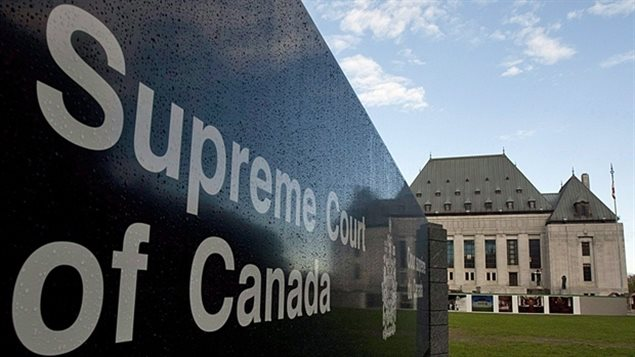 The Supreme Court of Canada on Thursday ruled for the first time ever on animal protection legislation. We see a long shot with the grey Supreme Court building in the distance. On the left we see the black government sign identifying the edifice.