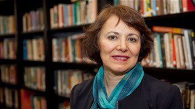 Homa Hoodfar, a Concordia University professor, was first arrested in March and then taken to Iran's infamous Evin prison earlier this week. Amnesty International is calling for her release. We see a sandy-haired lady dressed in a stylishly academic fashion (a two-toned blue scarf wrapped about her neck over dark blue jacket) looking directly with clear eyes at the camera. Behind her are the bookshelves of a library.