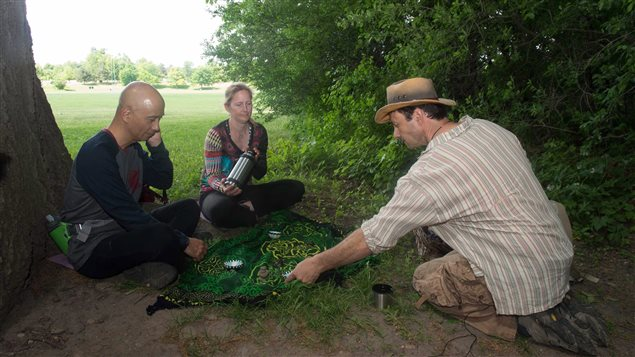 Ben Porchuk, right, guided a forest therapy session with Ruthanne Henry and Real Eguchi at Toronto's Sunnybrook Park.