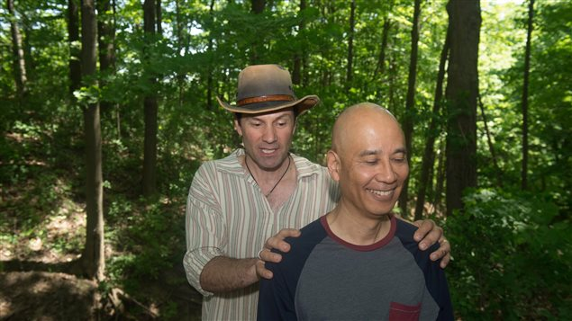 Ben Porchuk, left, led a session of forest therapy at a park in Toronto today. He is head of Canada's Association of Nature and Forest Therapy Guides and Programs.