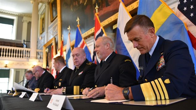 U.S. Coast Guard Commandant Adm. Paul Zukunft (right) and the heads of seven other Arctic nations' coast guards sign a joint statement in Faneuil Hall in Boston, June 10, 2016. (Petty Officer 2nd Class Patrick Kelley/U.S. Coast Guard)