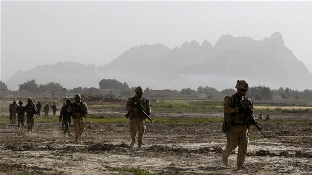 Canadian soldiers from 4th platoon, Bulldog company 1st Battalion, Royal 22nd Regiment walk during a patrol in the Panjwai district of Kandahar province southern Afghanistan, June 16, 2011.