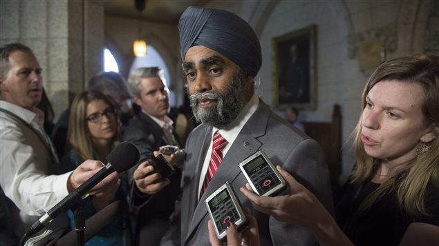 Minister of National Defence Minister Harjit Sajjan speaks with the media before Question Period on Parliament Hill Wednesday June 15, 2016 in Ottawa.
