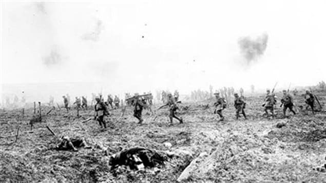 Canadians advance over bodies and through German barbed wire as deadly shrapnel shells explode above. Canadian took the ridge where British and French had failed.