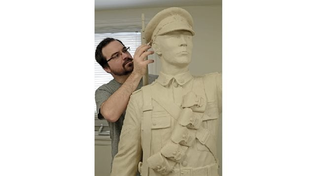 Showing scale, artist Tyler Fauvelle sculpts the Sergeant Francis Pegahmagabow figure for the three-metre bronze statue that honours Canada's most decorated Aboriginal war hero.