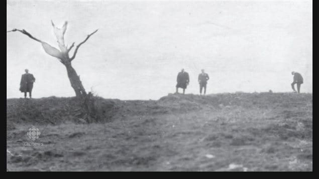 Presumably a postwar photo showing The Danger Tree, a landmark about halfway between the Newfoundland and German trenchs and used by the Germans as a sighting in range finder. Tragically it was also a place where the barbed wire had been cut and one of the narrow ways through the wire funneling the soldiers who were easy targets in the clear valley in broad daylight.