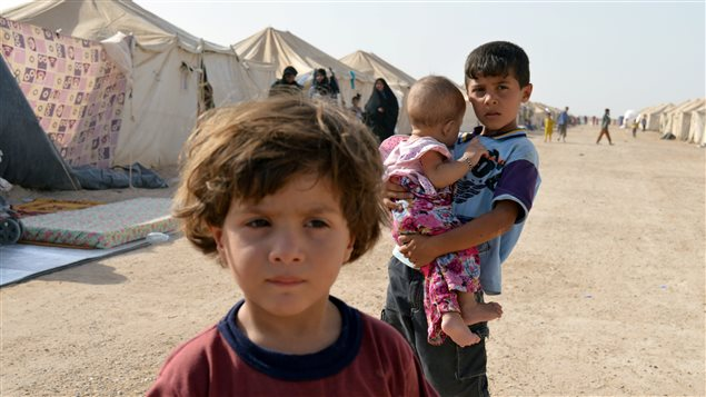 Displaced Iraqi children, who fled from Falluja because of Islamic State violence, are seen at a camp on the outskirts of Falluja, Iraq, June 22, 2016