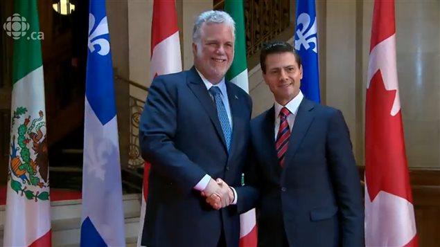 Philippe Couillard, primer ministro de Quebec y Enrique Peña Nieto, presidente de México.