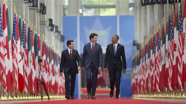 President Barack Obama walks with Canadian Prime Minister Justin Trudeau and Mexican President Enrique Pena Nieto at the National Gallery of Canada in Ottawa, Canada, Wednesday, June 29, 2016.