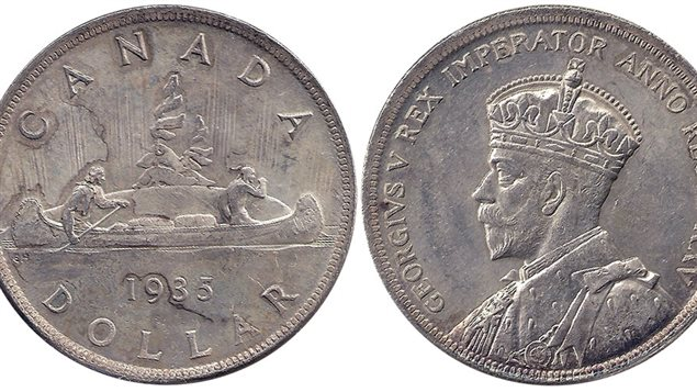 The original one-dollar coin was created in 1935 to celebrate the 25 years of King George V's reign. The voyageur was the most commonly minted reverse image though special editions were minted over the decades. Originally mostly silver, the silver content was reduced over the years until the coin was replaced by the 'new' gold-coloured coin in 1987. Originally to use the 'voyageur' design, the dies were strangely 'lost' in transit leading to the loon image and name 'loonie'