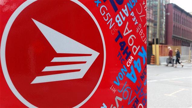 Le logo de Postes Canada.