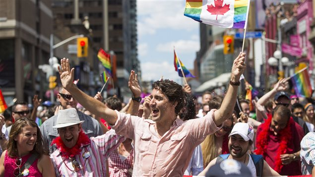 Prime Minister Justin Trudeau takes part in the annual Pride Parade in Toronto on Sunday, July 3, 2016. Pride Montreal said it tripled its security budget to deal with high-profile attendees, and to address fears in light of several high-profile car-ramming attacks.