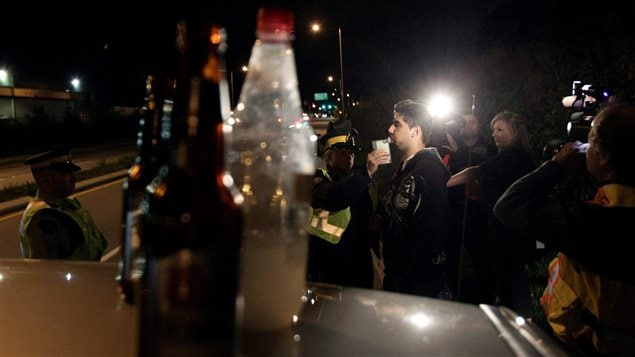 Finding open bottles of alcohol gave police the authority to test the driver for alcohol levels in this incident in September 2010 in Surrey, British Columbia.