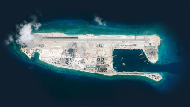 ..to full blown large island with military base with sheltered port, long airstrip and vast infrastructure by Sept. 2015