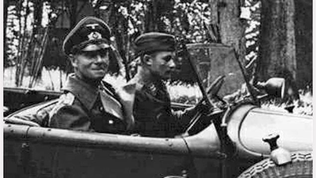 Field Marshal Erwin Rommel in his Horch staff car. Unlike many officers, he liked to sit up front. had he been tn the back, he might not have suffered the severe head injuries from the crash which ended his war, and which changed the course of the Normany campaign which continued without the leadership of one of Germany's best leaders.