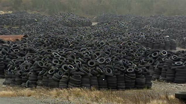 Imagine a world free of this. It could happen soon. We see thousands and thousands of black automobile tires stacked in endless piles.