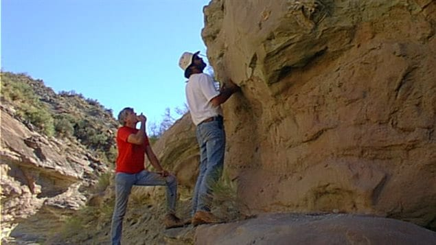 Professors Currie and Corria on the cliff face near Sierra Barrosa where the fossil was found originally in 2000.