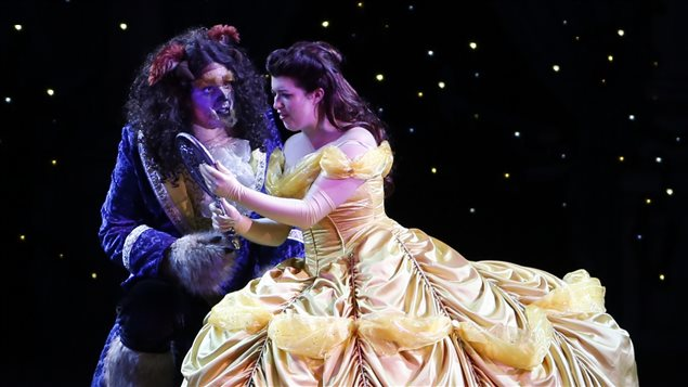 Jaime Piercy (Belle) and Peter Monaghan (The Beast) perform in Vancouver's Theatre Under the Stars (TUTS) directed by Shel Piercy.