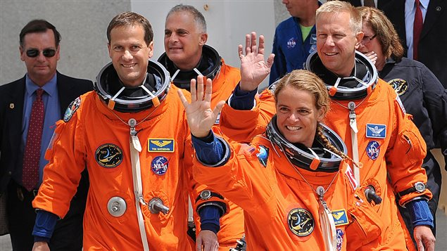 Canadian Space Agency astronaut Julie Payette (front) waves as she joins the crew of the space shuttle Endeavour STS-127 as they walk out to the astrovan July 13, 2009 at Kennedy Space Center in Florida