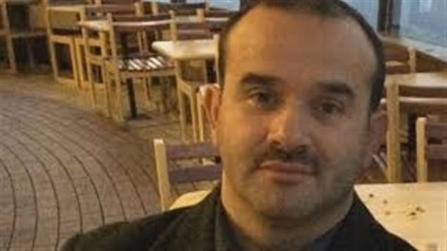 Davud Hanci is one of two dual Canadian-Turkish citizens currently being held in Turkey in the wake of the July 15 failed coup. So far, Canadian diplomats have been rebuffed in attempts to meet with them. We see a man from the shoulders up. His dark hair is beginning to recede. He has dark eyes wears a thin moustache.