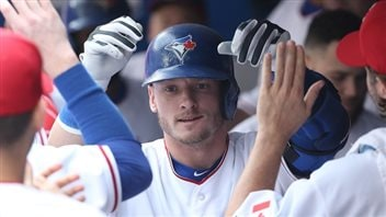 No matter what happens with the pitching, the Jays need Josh Donaldson to supply needed spark to the offence. We see Donaldson in his blue batting helmet getting high-fives in the dugout. He has a wispy blond beard.