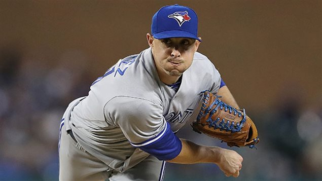 Aaron Sanchez, arguable Toronto's best pitcher, appears headed to the Toronto bullpen following Monday's trade deadline. We see Sanchez finishing off a pitch in his grey and blue Toronto away uniform.