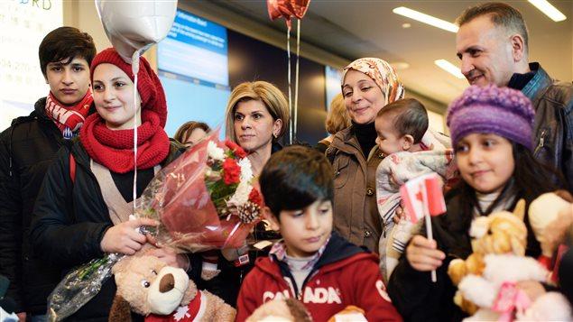 Des réfugiés Syrien arrivent au Canada. Crédit photo : Jimmy Jeong / Reuters