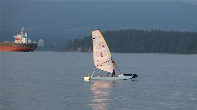 It looks like a cross between a small sailboat and a windsurfer, but *Ada* is a high tech, autonomous vessel about to sail unaided across the North Atlantic. If successful, it will be a world's first. Ada is shown here on a test sailing in the Pacific at Vancouver Harbour