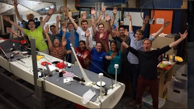 Some of the UBC students who have worked in creating the autonomous sailboat over the past several years.