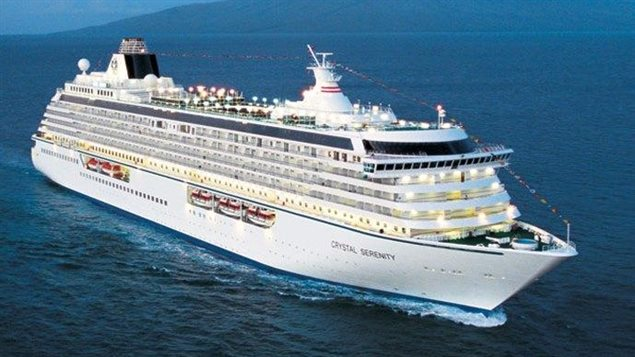 With passengers and crew, there will be about 2,000 people aboard the huge *Crystal Serenity* as it travels across the Arctic this month