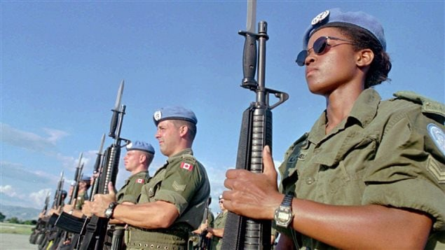 Canadian peacekeepers prepare for a parade at Maple Leaf Camp in Port-au-Prince, Haiti on Nov.28, 1997. The Trudeau government has promised to get Canada back into thepeacekeeping business, but a new report from two independent think tanks says the military is ill-prepared for the task
