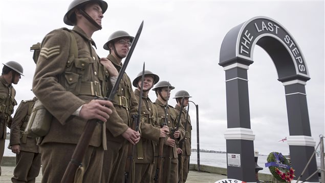 """Soldiers in period dress attended the unveiling of """"The Last Steps"""" memorial in the eastern port of Halifax."""