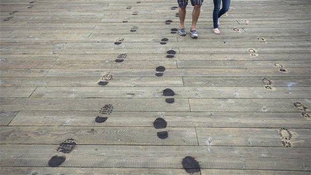 Footprints burned into the boardwalk symbolize the last steps thousands of Canadian soldiers took on home soil.