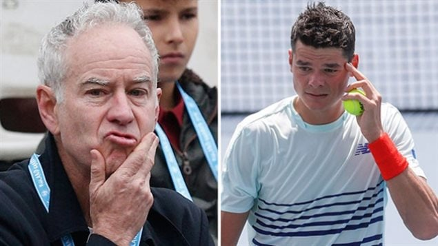 John McEnroe will not be coaching Milos Raonic at this year's U.S. Open. We a closeup of McEnroe with his right hand rubbing his chin and a slightly chagrined look on his kisser. Milos is on the right, dressed in white, rubbing his forehead with his left hand.