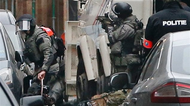 Police in Belgium surround the house and later arrest Salah Abdeslam, a 26-year-old suspect in last year's deadly Paris attacks. A survey shows a majority of Canadians are now concerned about safetly when travelling abroad.
