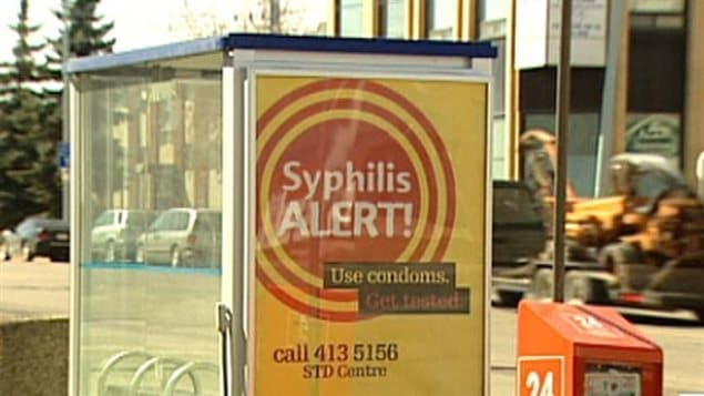 A 2015 poster in Alberta promotes use of condoms and urges people to get tested for syphillis. STD rates in Canada had declined markedly in the 1990s but have been climbing back up ever since.