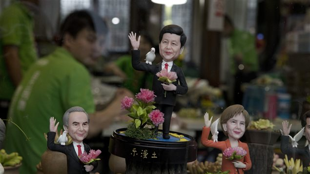 Clay figures of Chines President Xi Jinping, centre, and other foreign leaders are displayed in a shop window ahead of the G20 summit.