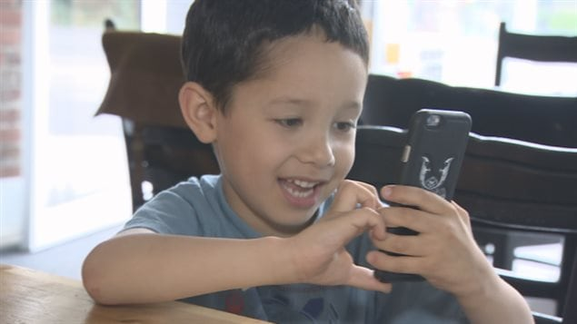 Joshua Casino is six and while he likes to play Pokemon Go, his father told CBC news he is 'a bit young for a cellphone.'