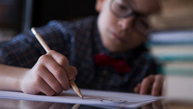Un enfant en classe