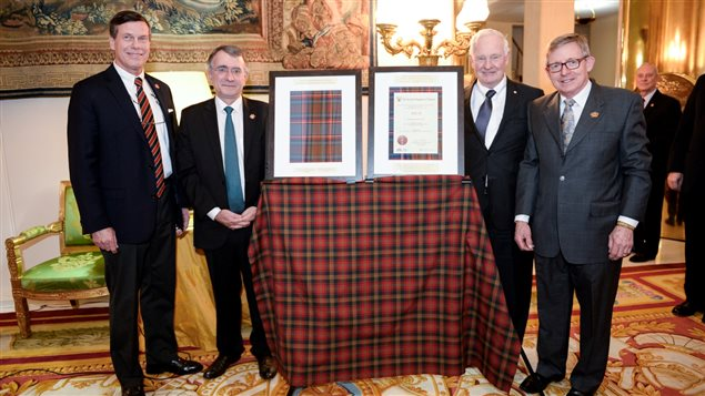 February 2016 and unveiling of new Hill 70 Tartan (framed). From L-R, Mark Hutchings, Nicholas Chapuis (Ambassador of France to Canada), His Excellency the Governor-General of Canada, David Johnson, and Mr Jim Reid.