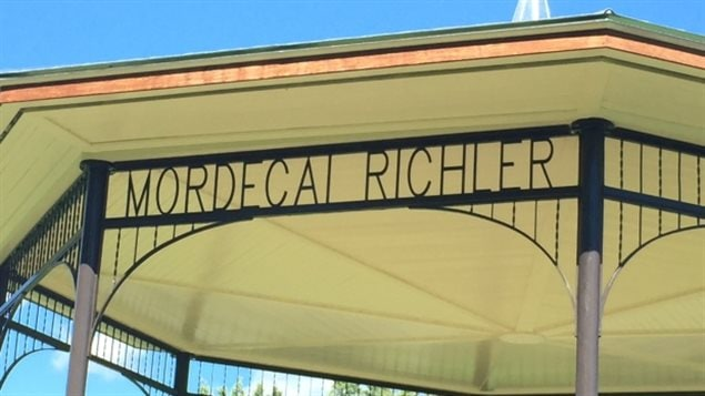 The author's name appears above the steps leading up to the bandstand.